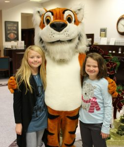 two girls standing with Tiger Mascot